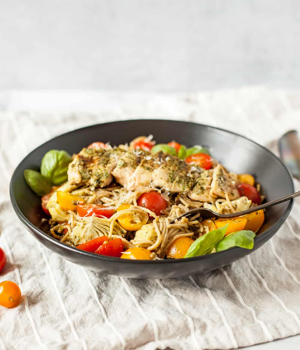 Looking for a flavorful and healthy recipe for fueling your body after an active day? Our Grilled Chicken Pesto Pasta is a balanced meal with healthy fats, complex carbohydrates, and lean protein. This is a delicious healthy chicken pasta recipe that will add some variety to your meal plan and will refuel your working muscles. | MarathonHandbook.com #healthyrecipe #chicken #pesto